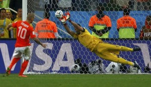 Argentina's goalkeeper Romero saves the third penalty shot from Sneijder of the Netherlands during a penalty shootout in their 2014 World Cup semi-finals in Sao Paulo